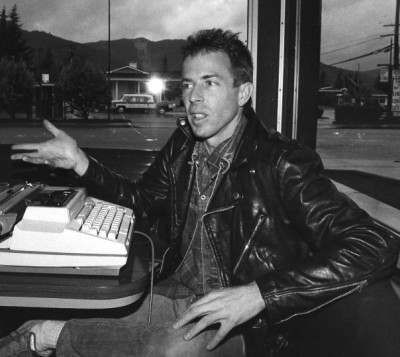 Larry Livermore holding forth with his (unplugged) electric typewriter at the Ukiah Denny's. Photo by R.D. Deines for the New Settler Interview, spring 1986.